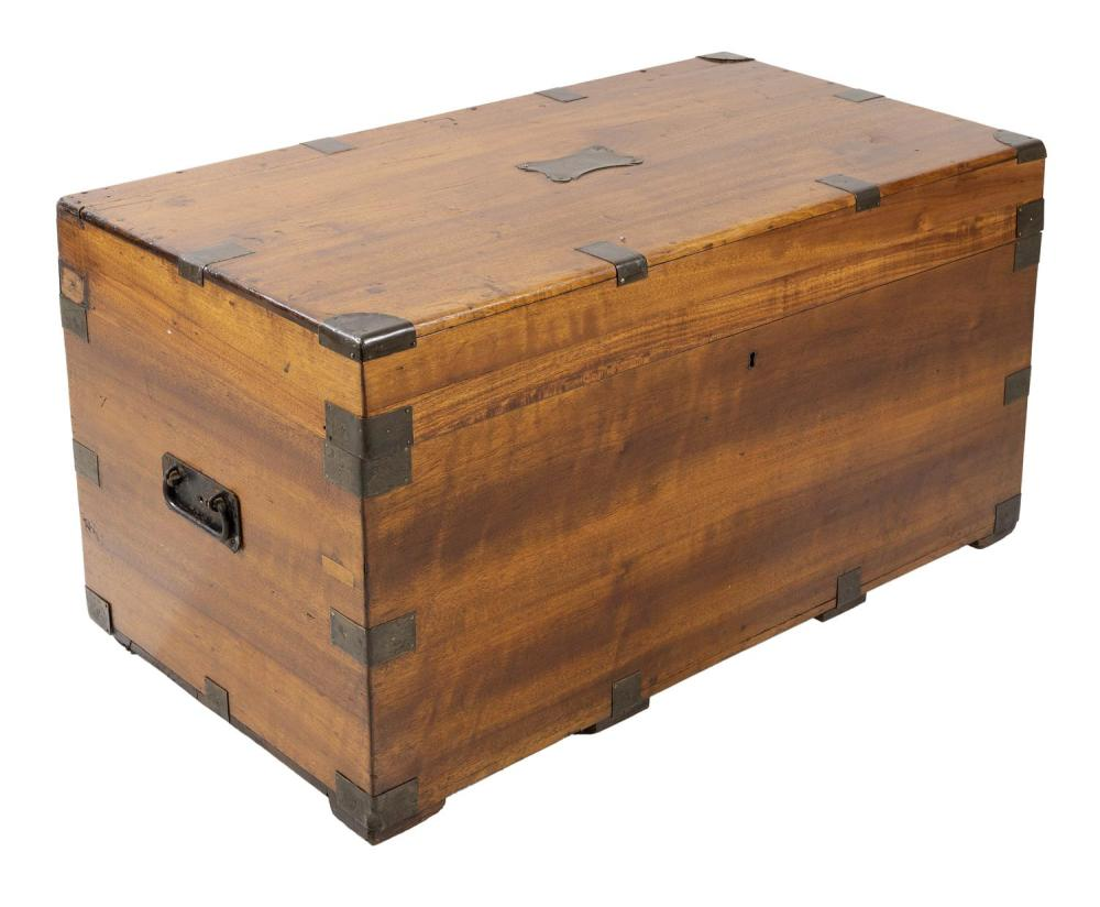 "BRASS-BOUND CAMPHORWOOD TRUNK With lift top and iron bail handles. Height 21"". Width 38"". Depth 19""."