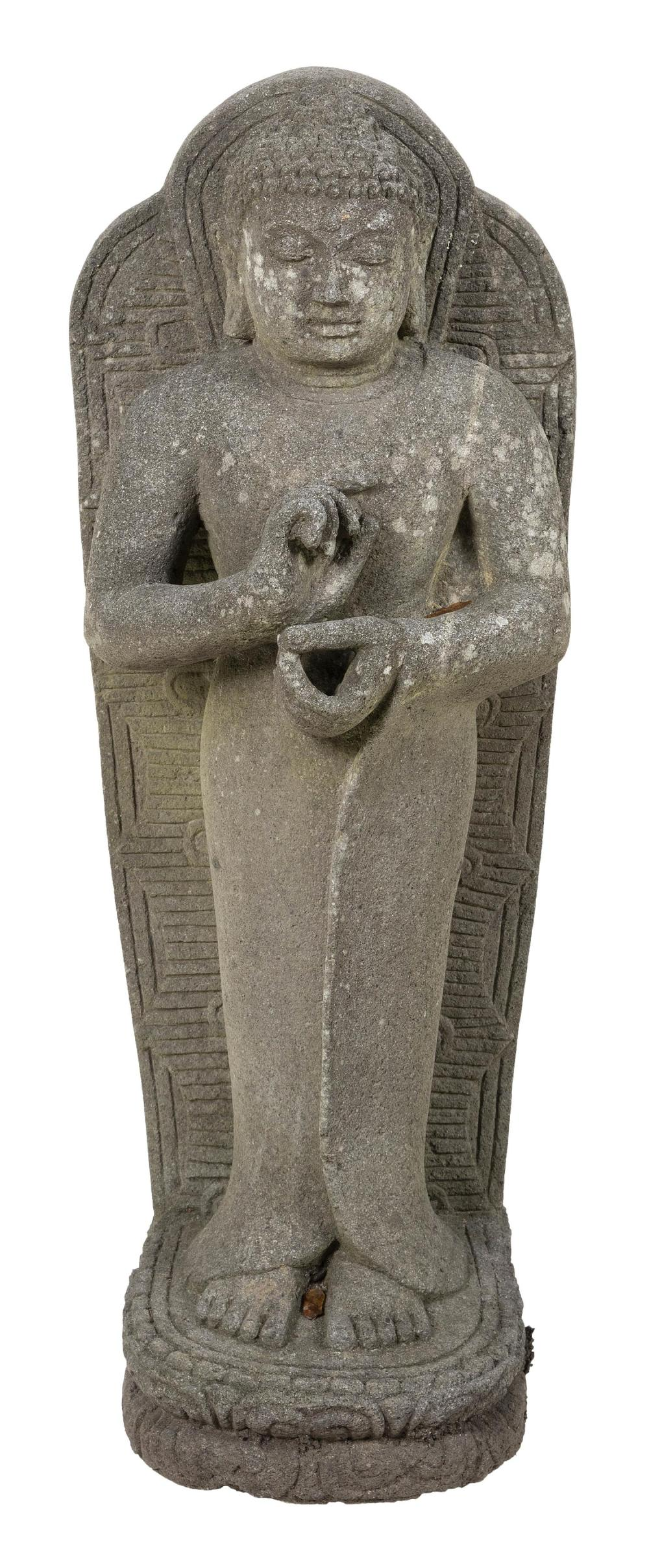 """STANDING BUDDHA STELE GARDEN SCULPTURE In robes, with his hands in dharmachakra mudra, on a lotus base. Height 31"""". Width 13"""". Depth..."""