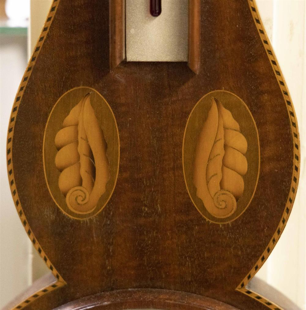 ANDREW J. LLOYD CO. BANJO BAROMETER Mahogany case with shell and pinwheel inlay and checkered banded inlay along perimeter. Marked o...