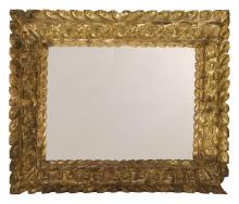 CONTINENTAL GILT-FRAMED MIRROR Frame with extensive foliate designs. Height 27.5