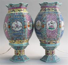 PAIR OF POLYCHROME PORCELAIN MARRIAGE LAMPS In hexagonal form with pierced sides depicting Buddhistic symbols and figures. Heights 1...
