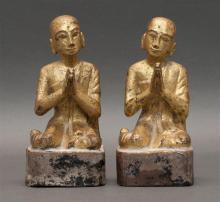 PAIR OF ASIAN CARVED GILTWOOD FIGURES In the form of kneeling acolytes with their hands clasped in prayer. Heights 7.75