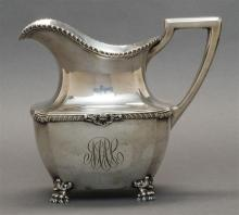 DOMINICK & HAFF STERLING SILVER WATER PITCHER Retailed by Bigelow, Kennard & Co. Squat with gadrooned rim and shoulder. Shoulder fur...