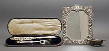 THREE PIECES OF BRITISH STERLING SILVER 1) Victorian cased fish-serving fork and knife. Birmingham, 1853. Hilliard & Thomason, maker...