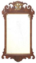 CHIPPENDALE-STYLE MIRROR In mahogany with gilt phoenix crest and nicely carved ears. 39