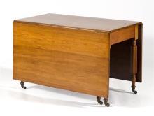 AMERICAN SIX-LEG DROP-LEAF TABLE In walnut with unusual broadly reeded legs. Height 28.50