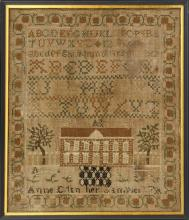FRAMED NEEDLEWORK SAMPLER Depicts alphabets and numerals above a house flanked by trees. Illegible date and maker''s inscription. 14...