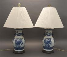 PAIR OF CHINESE BLUE AND WHITE PORCELAIN VASES In bird and flower design. Mounted as table lamps. Heights overall 30