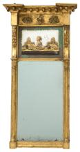 GILT AND ÉGLOMISÉ TABERNACLE MIRROR Frieze with ball drops and a reverse gilt-painted glass of houses in a landscape flanked by rais...