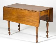ANTIQUE AMERICAN SHERATON DROP-LEAF TABLE In mahogany on reeded tapered legs. Height 27.5