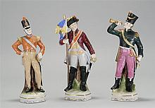 SET OF THREE GERMAN PORCELAIN NAPOLEONIC SOLDIER FIGURES Heights from 9¾