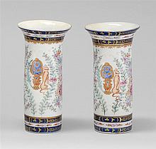PAIR OF SAMSON PORCELAIN VASES With enameled floral decoration and coat of arms on both sides. Unmarked. Heights 7¼