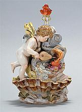 MEISSEN PORCELAIN MATCH HOLDER In the form of a cherub standing in a fountain with a shell-form receiving bowl. Crossed swords mark...