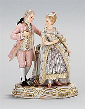 MEISSEN PORCELAIN FIGURAL GROUP A man helping a woman rise from a chair. Crossed swords mark on base. Height 6