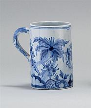DELFT POTTERY MUG In cylinder form with blue and white floral design about a heraldic crest. Monogram signature on base. Height 5½