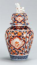 IMARI PORCELAIN COVERED JAR Domed cover with foo dog finial. Height 14½