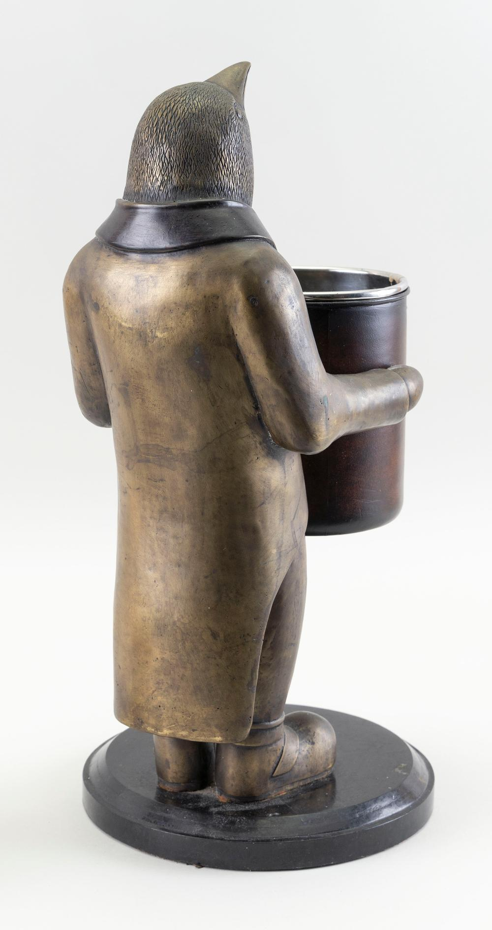 """WINE BOTTLE HOLDER IN THE FORM OF A PENGUIN Late 20th Century Height 17"""". Inside diameter of holder is 4.125""""."""