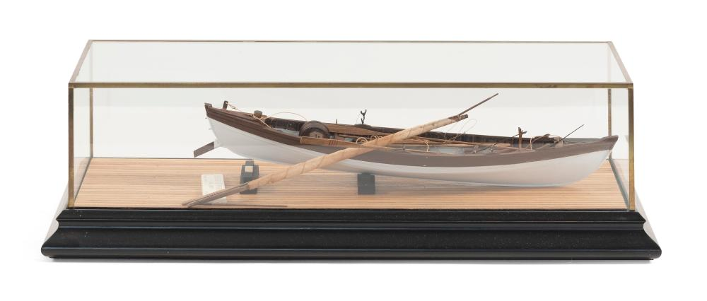 """CASED MODEL OF A BEETLE WHALEBOAT 20th Century Case height 5"""". Length 17.5"""". Width 7.25""""."""