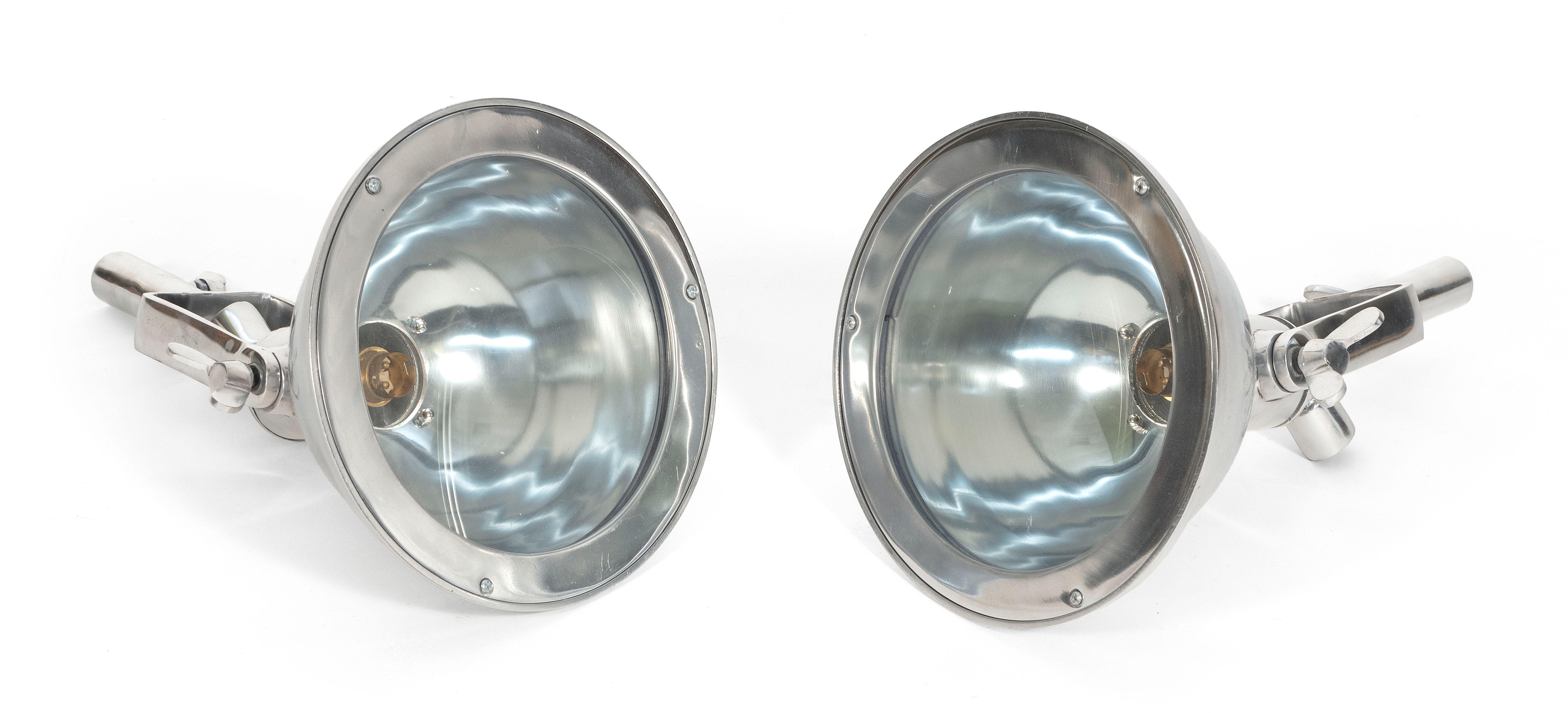 "PAIR OF ALUMINUM CARGO LIGHTS 20th Century Heights 14.25"". Lens diameters 7.75""."