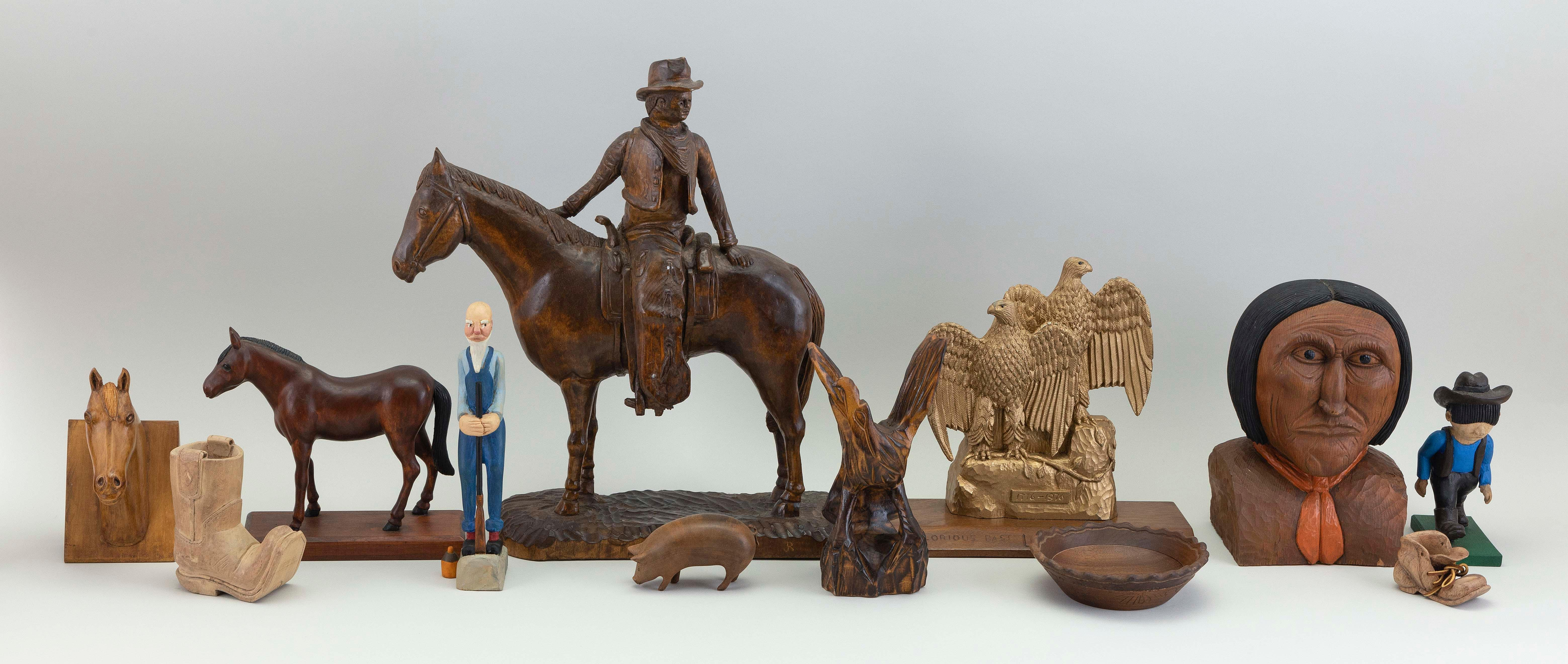 """COLLECTION OF TWELVE WOOD CARVINGS BY JULIUS RANDOLPH DOERING 20th Century Heights from 2"""" to 16""""."""