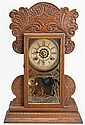 WATERBURY GINGERBREAD SHELF CLOCK with alarm. Reverse gilt-painted face glass. Height 22¼