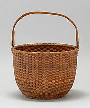NANTUCKET BASKET Attached swing handle and turned wooden base. Overall height 11½