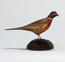 MINIATURE RING-NECKED MALE PHEASANT By A. Elmer Crowell of East Harwich, Massachusetts. Mounted on a chip-carved wooden base. Rectan...