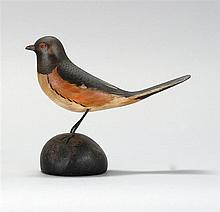 LIFE-SIZE DECORATIVE CARVED TOWHEE By A. Elmer Crowell of East Harwich, Massachusetts. Painted tack eyes. Mounted on an oval painted...