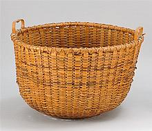 LARGE NANTUCKET BASKET With side carrying handles. Wood base. Overall height 14
