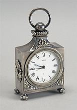 SILVER PLATED BOUDOIR CLOCK BY ANGELUS with foliate and ribbon design. Swiss alarm movement. Height 6