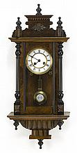 19TH CENTURY FRENCH CASED WALL CLOCK in mahogany and mahogany veneer. Black-painted columns and finials. Height 25