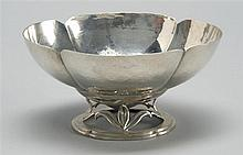 HAND-HAMMERED STERLING SILVER FOOTED BOWL in lobed form. Foot with openwork foliate design. Marked