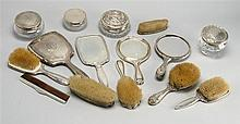 FIFTEEN STERLING SILVER-MOUNTED DRESSER ITEMS. Non-matching. Includes four glass jars with silver lids, six brushes, one comb, and f...