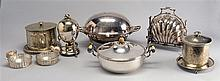 EIGHT SILVER PLATE HOLLOWARE PIECES by various makers. Includes two biscuit boxes, egg warmer, scallop-form biscuit holder, two glas...