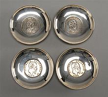 FOUR VITTORIO EMANUELE II 5 LIRA COINS MOUNTED IN .925 SILVER NUT DISHES. Diameters 3.25