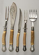 FIVE STAGHORN SERVING PIECES with sterling silver mounts. Includes two meat forks, a carving knife, a fish fork, and a fish knife, l...