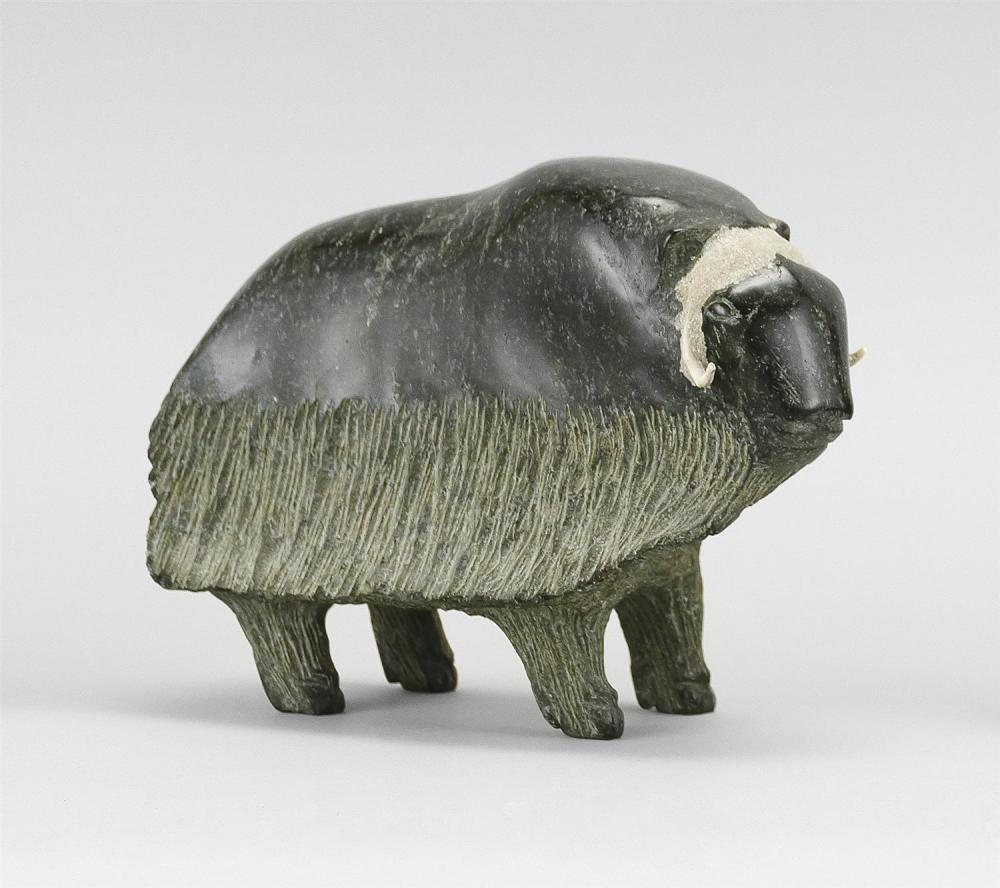 """ESKIMO SOAPSTONE CARVING OF A MUSKOX With contrasting applied horns. Unmarked. Length 7.25"""". From a Long Island Collection."""