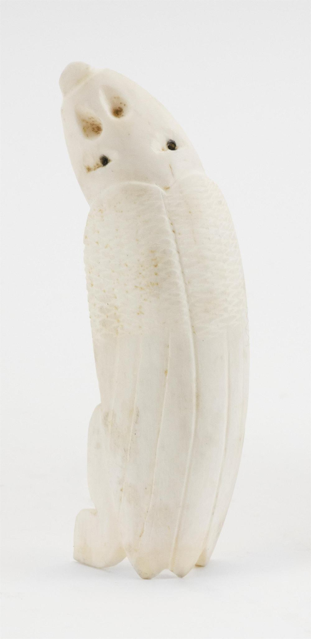 """INUIT WALRUS IVORY CARVING OF AN INSECT-LIKE TUPILAK With inlaid eyes. Length 4.4"""". This item is not available for international del..."""
