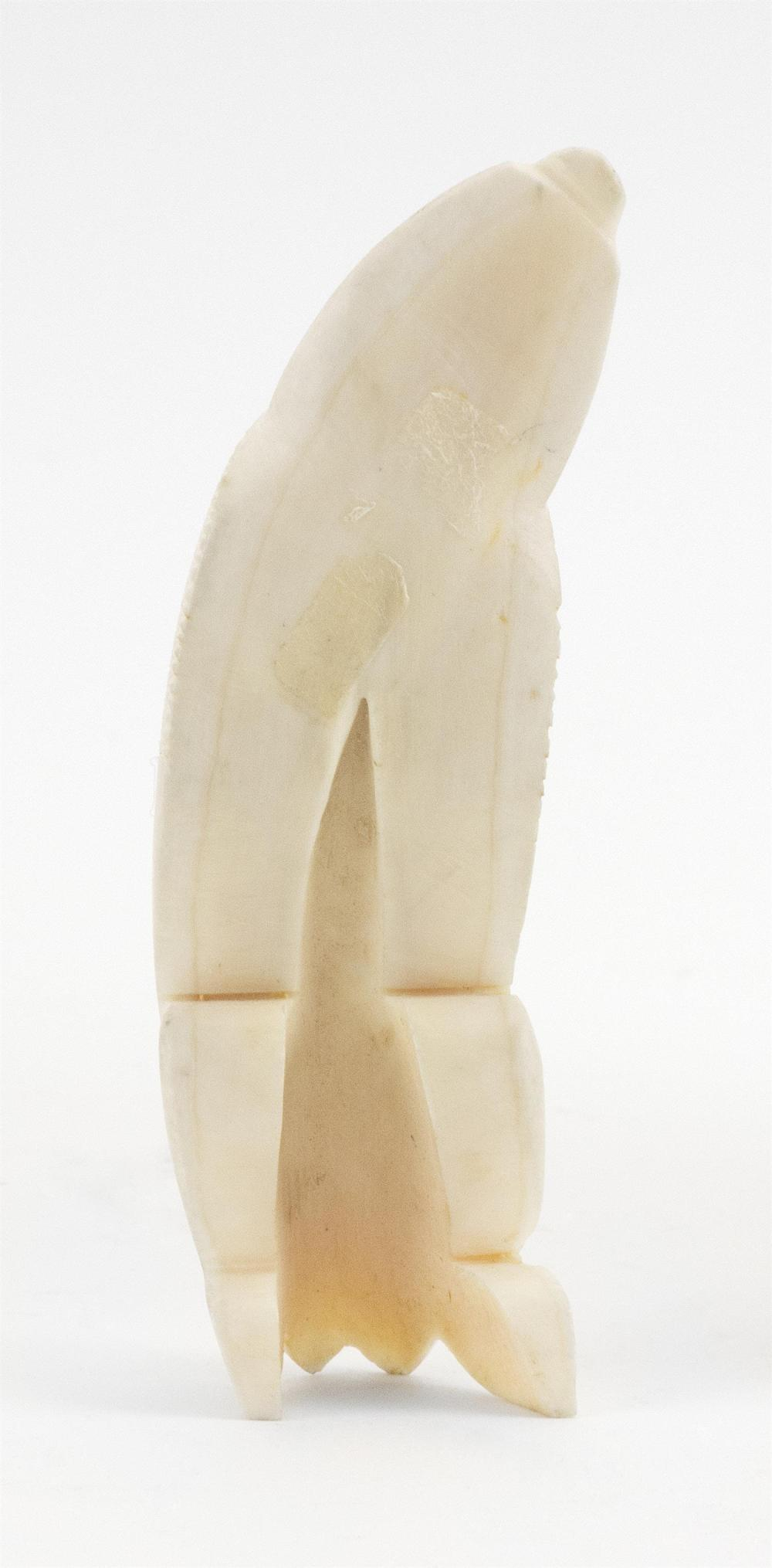 INUIT WALRUS IVORY CARVING OF AN INSECT-LIKE TUPILAK With inlaid eyes. Length 4.4