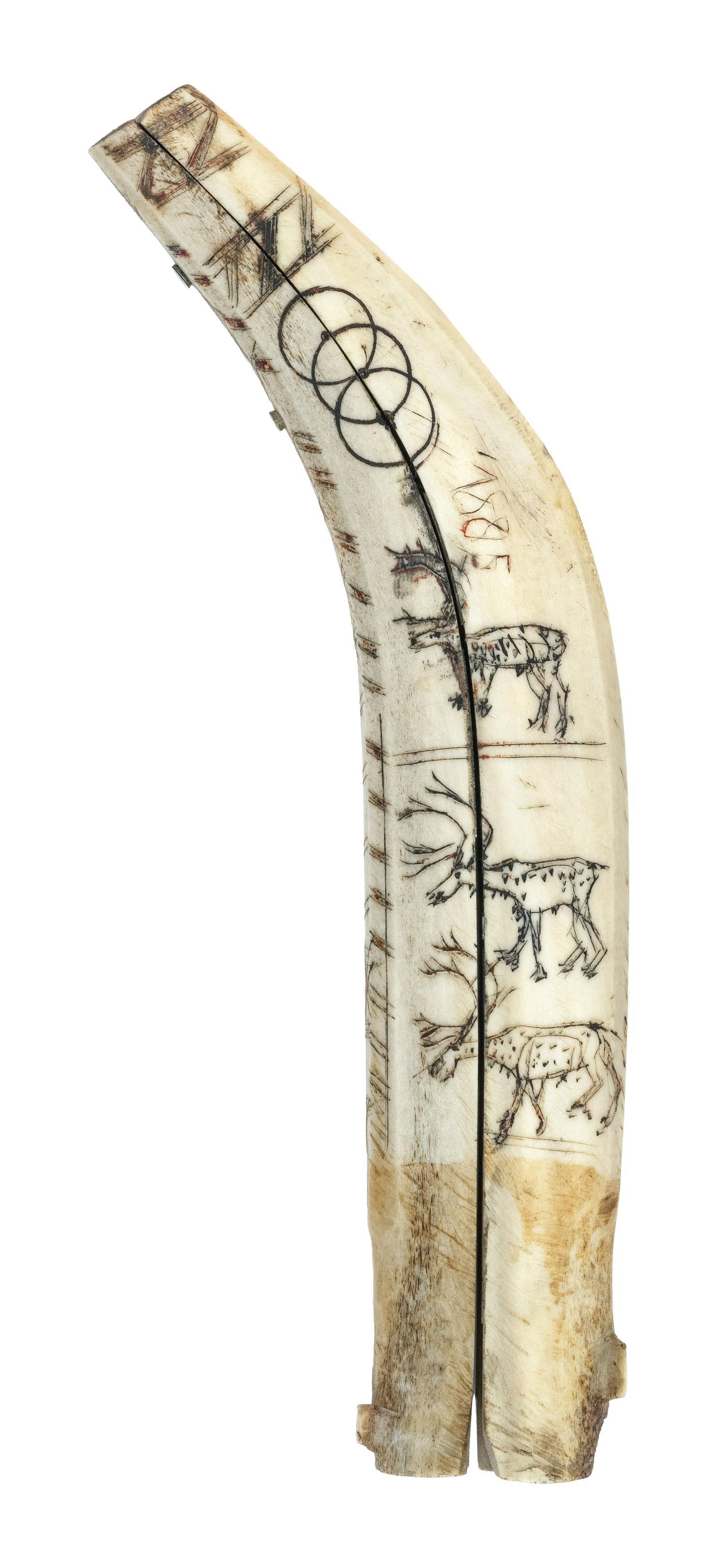 "ESKIMO ENGRAVED BONE KNIFE SHEATH Depicts four stag and multiple geometric designs. Dated 1885. Length 8.75"". Not available for inte..."