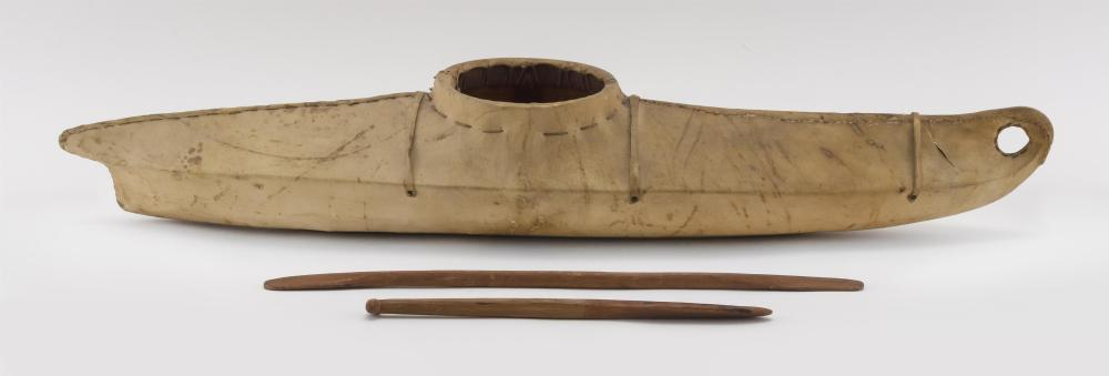 HIDE-COVERED MODEL OF AN ESKIMO KAYAK With wood frame. Includes two wooden paddles. Length 27