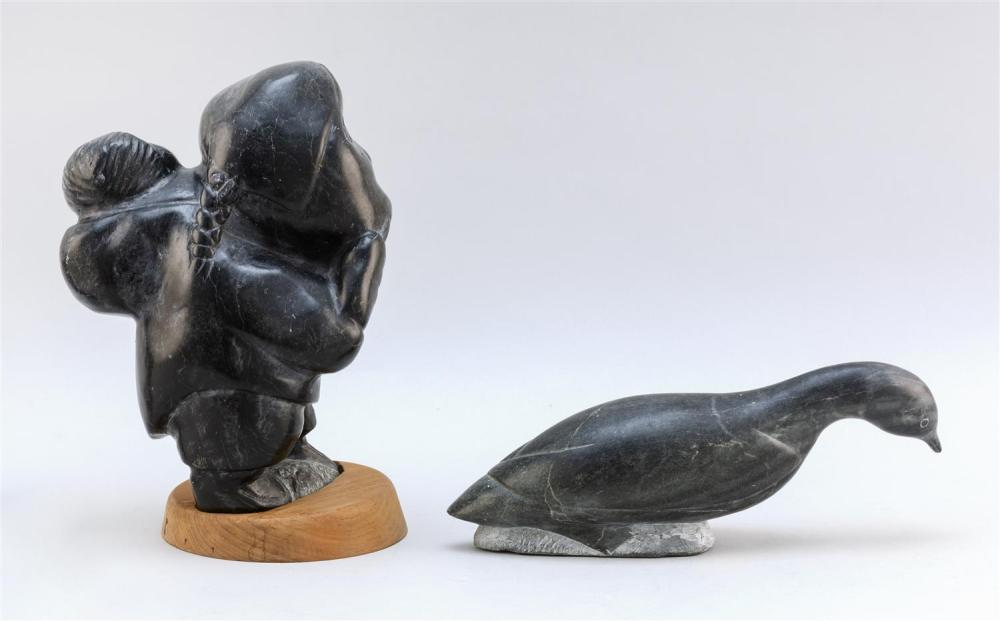 TWO INUIT ESKIMO SOAPSTONE CARVINGS Woman with Papoose on wood base carved of black soapstone. Canadian label and