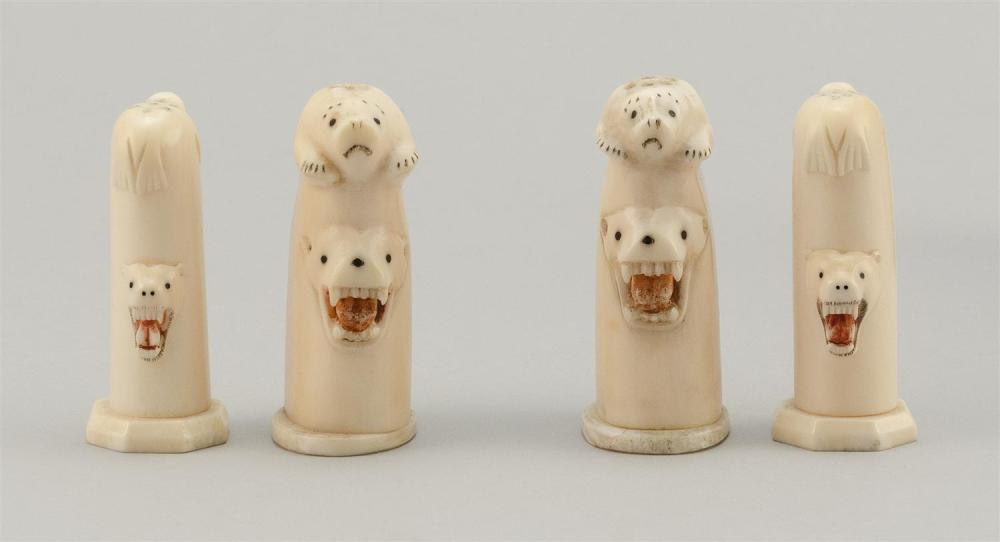 "PAIR OF ESKIMO WALRUS IVORY SALT AND PEPPER SHAKERS Both sets with relief seals, walrus and polar bear heads. Heights approx. 2.75""...."