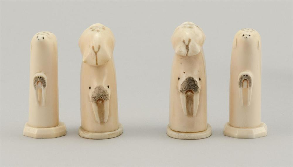PAIR OF ESKIMO WALRUS IVORY SALT AND PEPPER SHAKERS Both sets with relief seals, walrus and polar bear heads. Heights approx. 2.75