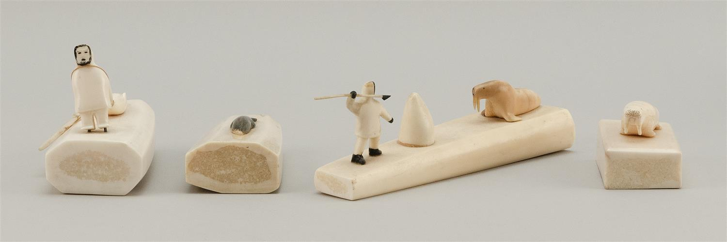 """FOUR ESKIMO WALRUS IVORY CARVINGS Mounted with carved seals, fish, walrus and Eskimos. Lengths from 2.75"""" to 6.75"""". This item is not..."""