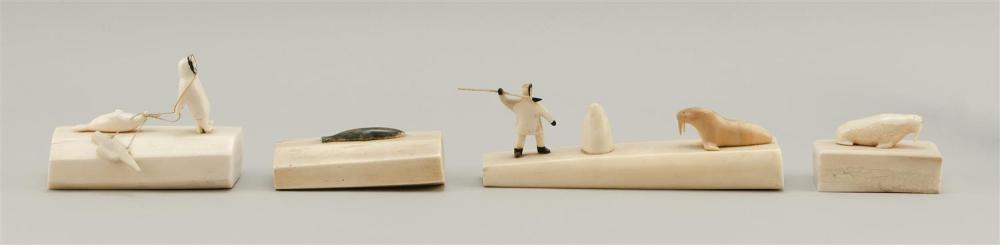 FOUR ESKIMO WALRUS IVORY CARVINGS Mounted with carved seals, fish, walrus and Eskimos. Lengths from 2.75