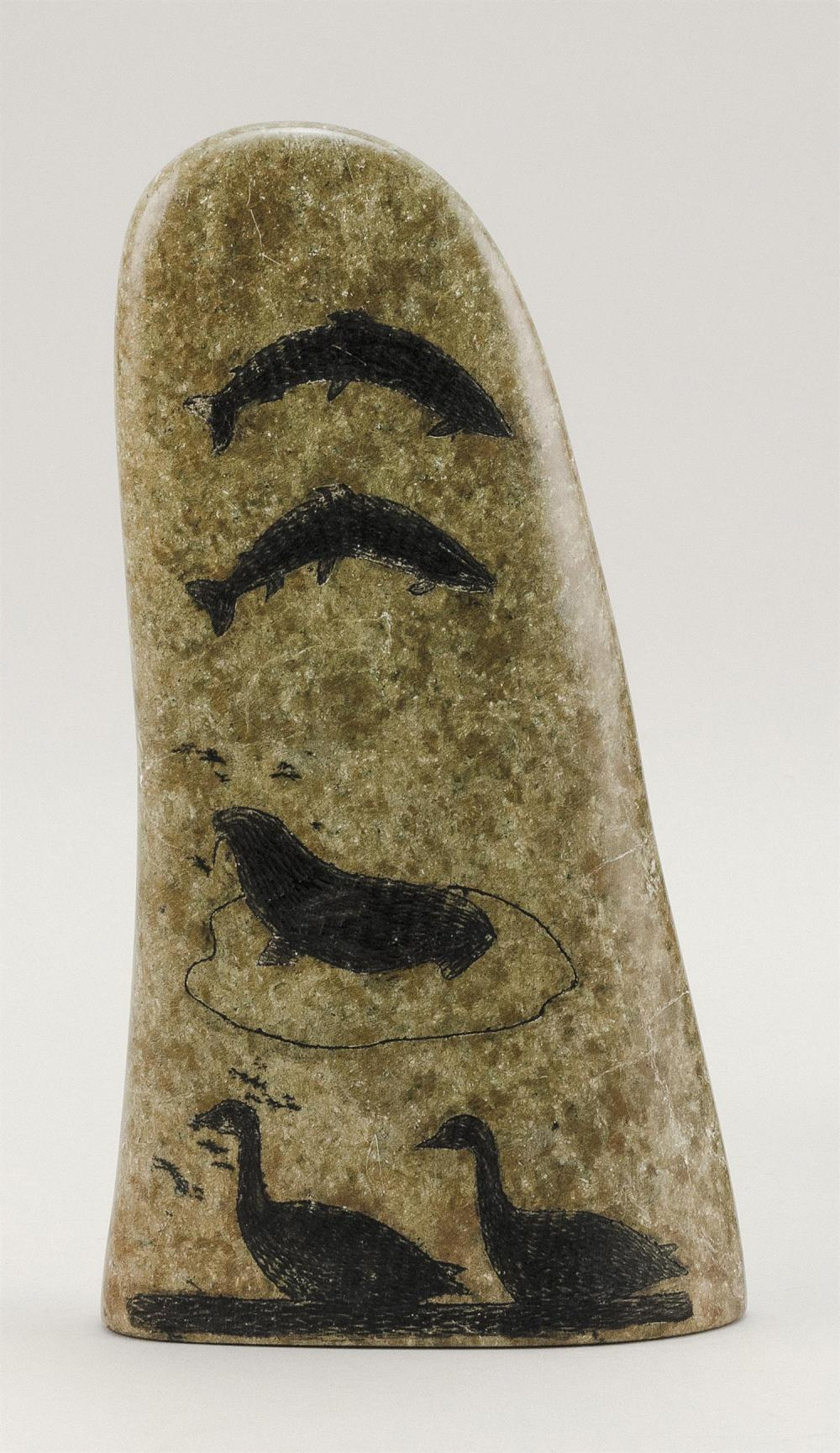ESKIMO ENGRAVED GRANITE SCULPTURE In the form of an orca's fin, each side engraved with fish, seals, birds and igloos. Etched signat..