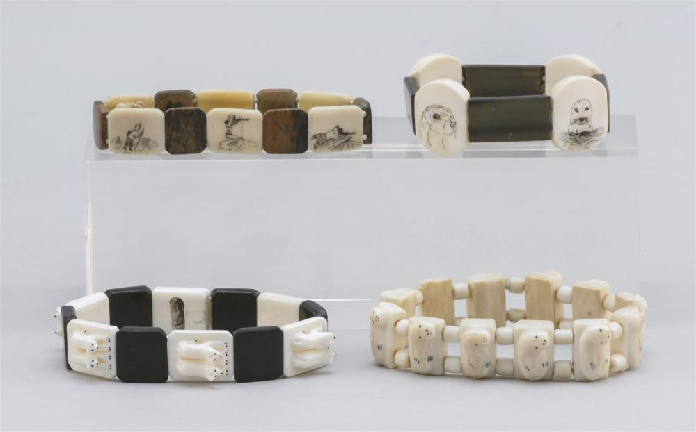 FOUR ESKIMO WALRUS IVORY BRACELETS Two with engraved panels depicting Arctic scenes, and two with relief-carved seals. This item is...