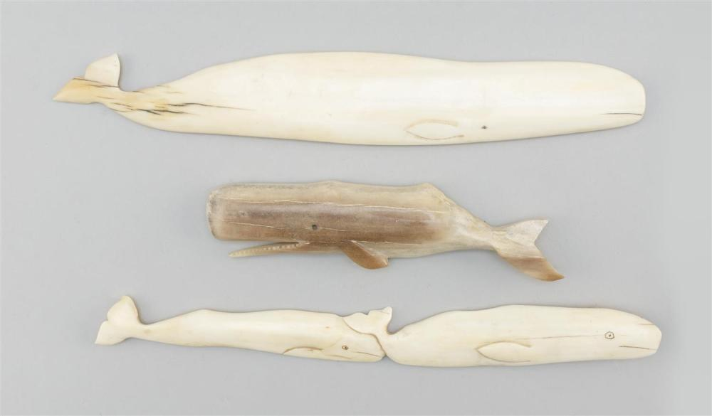"""THREE ESKIMO WHALE CARVINGS Two carved from walrus ivory and one carved from petrified bone. Lengths from 5.5"""" to 9.25"""". This item i..."""