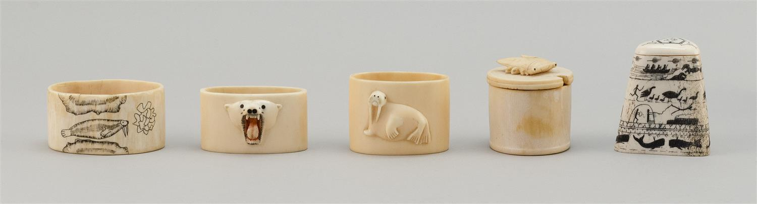 FIVE ESKIMO BONE AND WALRUS IVORY ITEMS A box is engraved with whales, birds and human figures, a cylindrical box with a relief-carv...